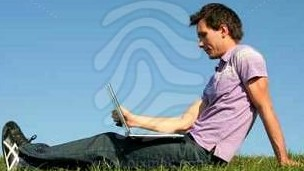 man-using-a-laptop-outdoors