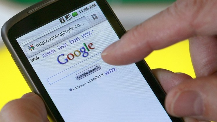 117490-a-man-searches-on-google-from-his-smartphone