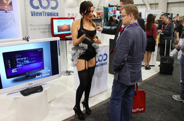 lets-start-out-here-not-sure-what-shes-selling-but-this-booth-babe-spent-a-lot-of-time-telling-these-guys-about-windows-8-it-has-an-app-store-where-you-can-download-apps-insightful