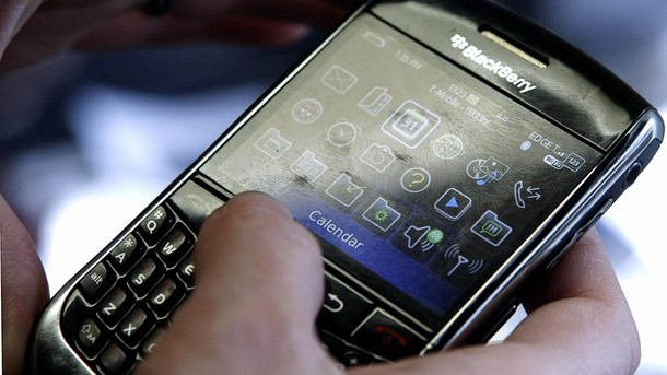 A BlackBerry smartphone user is pictured checking its Calendar in Washington