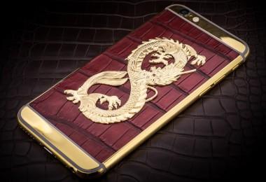 iPhone 6 adornado por un dragón de oro de 24 quilates con ojos de rubí descansando sobre piel de lagarto