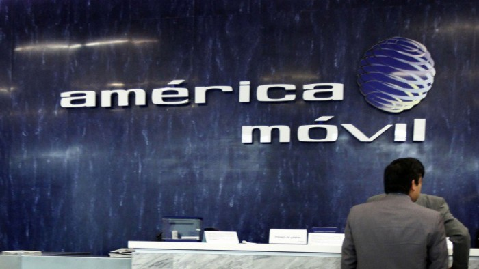 File photo of the logo of America Movil on the wall of the reception area in the company's corporate offices in Mexico City